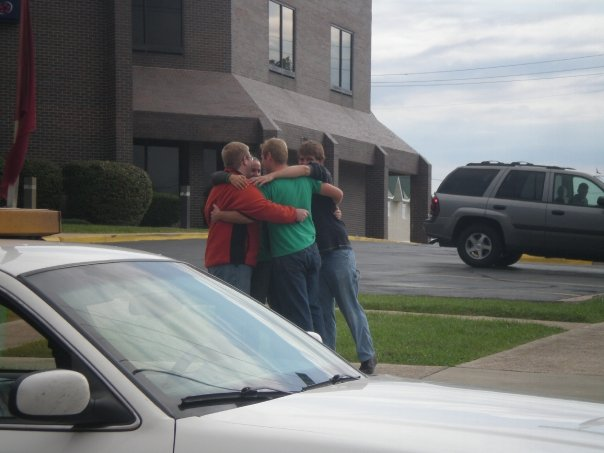 The Show-Me Solar team shares a group hug after seeing the house off